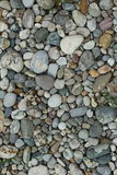 Pebble stones on the surface. Pebble stones on an area Royalty Free Stock Photo