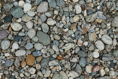 Pebble stones on the surface. Pebble stones on an area Royalty Free Stock Image