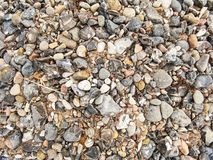 Pebble stones texture. Useful for design as natural background Royalty Free Stock Images