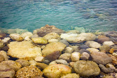 Pebble stones under transparent water. Nature background Royalty Free Stock Photo