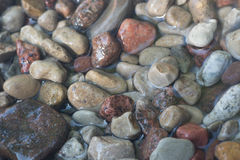 Pebble stones in water background Stock Image
