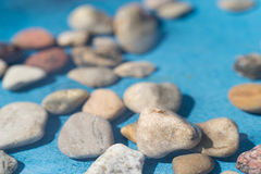 Pebble stones in water. Closeup Royalty Free Stock Photo
