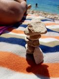 pebble tower on the Croatian beach stock photography