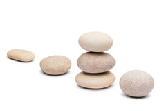 Pebble tower on a white background Royalty Free Stock Images