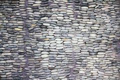 Pebble Wall Detail. Black river rock also called Mexican Pebble Royalty Free Stock Photo