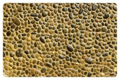 Pebble wall texture Stock Images