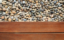 Pebble and wood Royalty Free Stock Photo