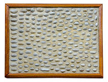 Pebble on wooden frame Stock Photos