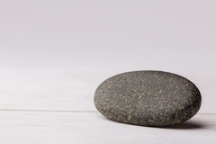 Pebble on a wooden table Stock Photo