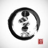 Pebble zen stones balance in black enso zen circle on white background. Pebble zen stones balance in black enso zen circle on white background. Traditional Royalty Free Stock Images