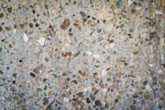 Pebbled betongbakgrund royaltyfri fotografi
