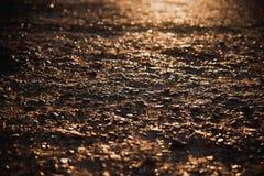 Pebbled moeu no por do sol Imagens de Stock Royalty Free