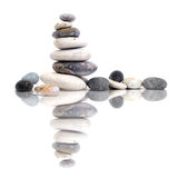 Pebbles. Pyramid of pebbles on a white background royalty free stock image