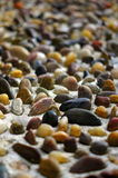 Pebbles. A walkway tiled with pebbles Stock Images