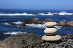 Pebbles 2. Pebbles stack on a volcanic rock near the sea Stock Images