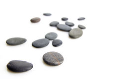 Pebbles. Scattered over white background Stock Photo