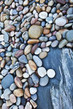 Pebbles. Colorful pebbles on a rocky beach Royalty Free Stock Photography
