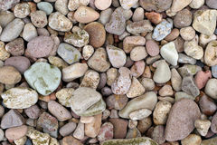 Pebbles. On a beach. Would make an ideal background stock images