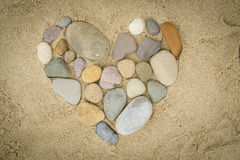 Pebbles arranged in a heart shape Royalty Free Stock Image