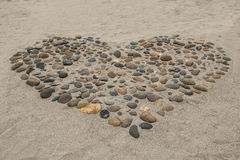 Pebbles arranged in a heart shape Royalty Free Stock Photos