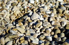 Pebbles background Stock Images
