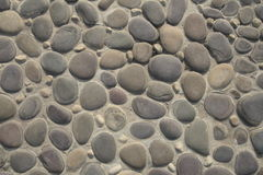 Pebbles Background. A background with a view of an abstract pattern made of a pebbles floor Royalty Free Stock Photography