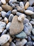 Pebbles background. Various stones of different shapes and sizes. Natural pebbles background. Various stones of different shapes and sizes. Outdoor decorations stock photos