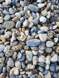 Pebbles background. Various stones of different shapes and sizes. Natural pebbles background. Various stones of different shapes and sizes. Outdoor decorations royalty free stock image