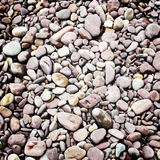 Pebbles background - vinatge filter. Stock Photos