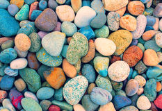 Pebbles background. Vintage background from colorful pebbles stock photography