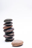 Pebbles balance, arrangement on the white background Stock Image