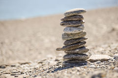 Pebbles in balancing on the beach Stock Photography