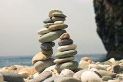 Pebbles in balancing on the sea coast Stock Photo