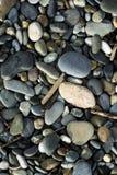 Pebbles on beach stock photography
