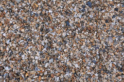 Pebbles on a Beach. Abstract Background of Pebbles on a Beach with Plenty of Copy Space Royalty Free Stock Photos