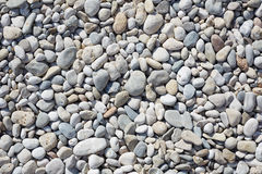 Pebbles on the beach, abstract stone background Royalty Free Stock Photo