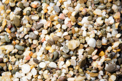 Pebbles on the beach as background Stock Image