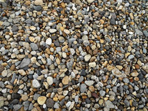 Pebbles on a beach - Background Royalty Free Stock Image