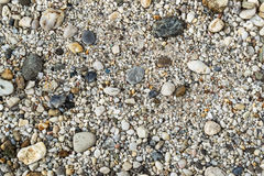 Pebbles on a beach. Background image of pebbles on a beach stock image