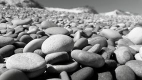 Pebbles at the beach Stock Images