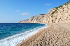 Pebbles Beach and Blue Sea Royalty Free Stock Photos