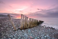 Bossington bay at sunset exmoor. Pebbles on the beach at bossington bay in summer exmoor somerset uk royalty free stock photos