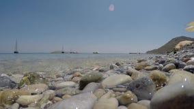 Pebbles beach. Close the sea stock video footage