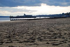 Pebbles on beach and pier. Pier at Bournemouth, England, pebbly beach in foreground Stock Photo