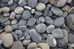 Pebbles on the beach. Round pebbles on the beach in portugal Stock Photography