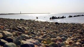 Pebbles on beach stock footage