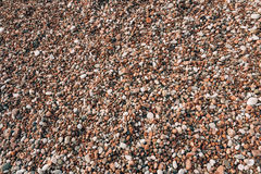 Pebbles on the beach. Texture of the sea shore. The Adriatic Sea Royalty Free Stock Photo