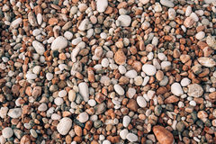 Pebbles on the beach. Texture of the sea shore. The Adriatic Sea Royalty Free Stock Photos