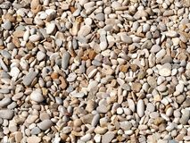 Pebbles on the beach topview background. Pebbles on the beach top view background royalty free stock photos