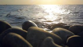 Pebbles Beach and waves splashes. Beautiful Sunset stock video